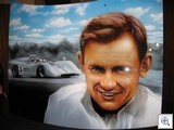 This remarkable portrait of Bruce McLaren is painted on a car bonnet (hood)
